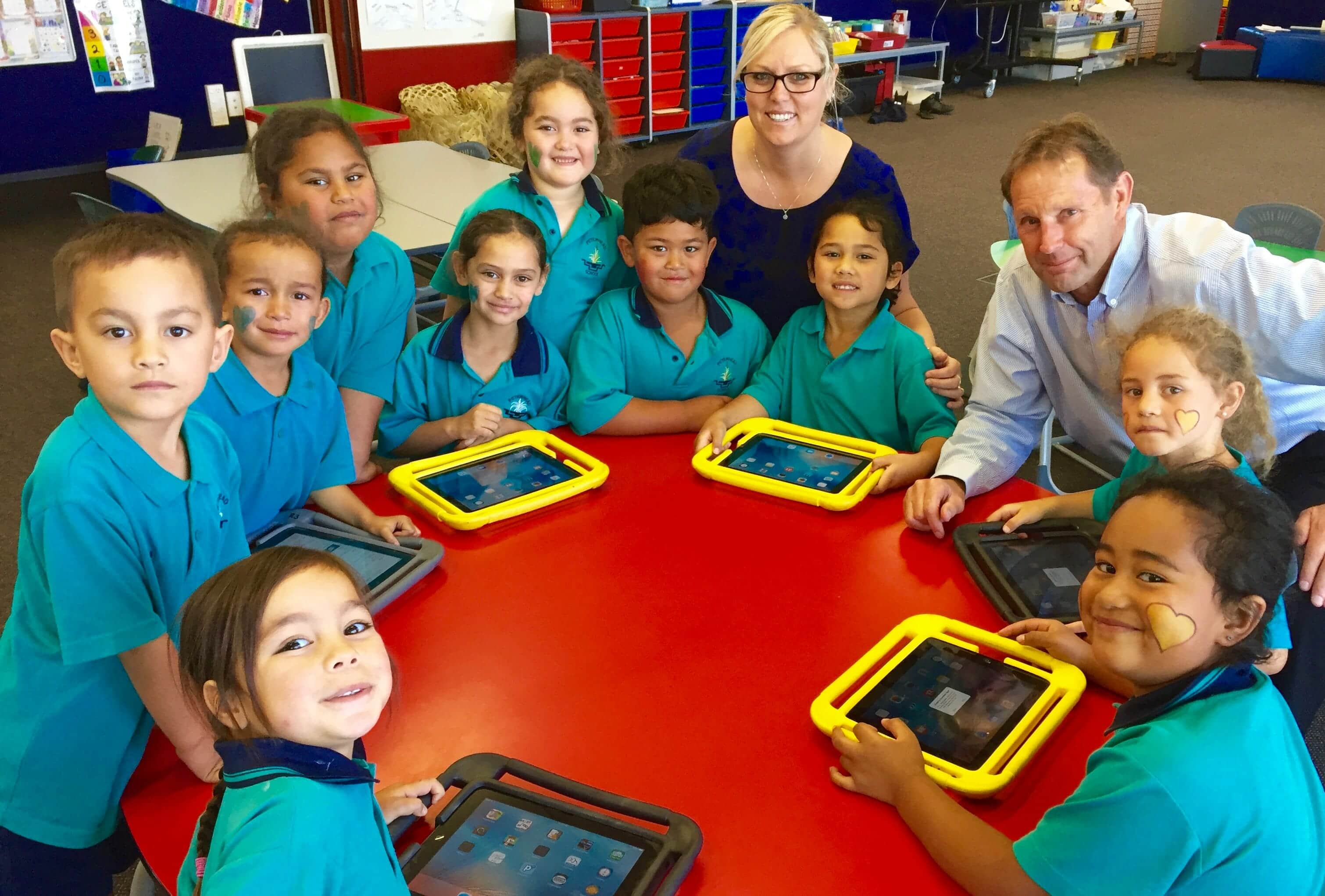 Peterhead principal Martin Genet and teacher Anna Berryman with a group of Year-1 students. Chromebook's, iPads and other devices provided through funding from the Flaxmere Licensing Trust have played a key role in improving student learning at the Flaxmere school.