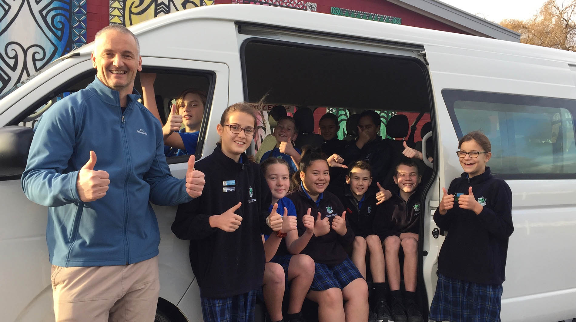 Lakeview School students, and principal Tim Nelson, give the thumbs up for their brand new Toyota van.